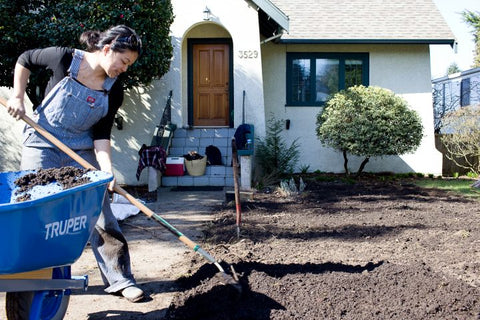 Person raking soil at house for Young Agrarians