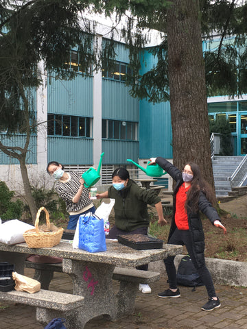Youth having fun learning about gardening at Farm to School BC