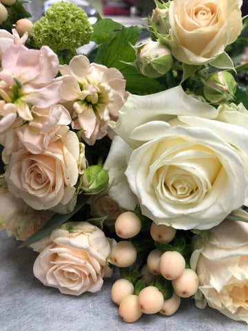 White and pink roses in a bouquet at Minter Country Garden