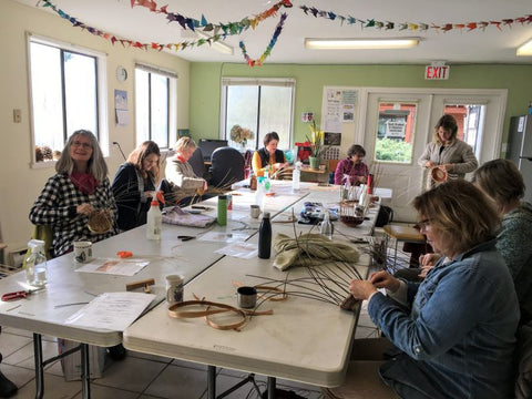 People in a classroom crafting at HCP Gardens