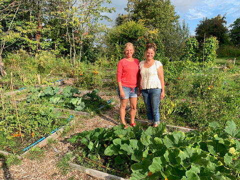 Two people standing in the gardens at Terra Nova Nature School