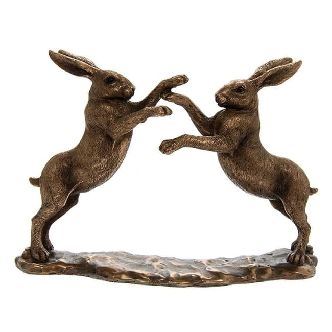 Two Bronze Hare's Play Boxing