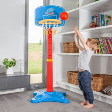 Boy Playing with Buzzer Beater Basketball Set