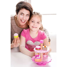 Mum and girl playing with wooden cupcake and stand - Image 1