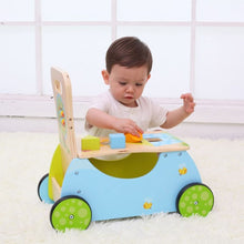 Boy playing with blocks - Wooden Rider and Walker Toy