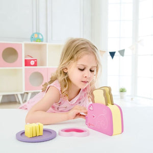 Girl playing with wooden Toaster Set - Image 1