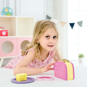 Girl playing with wooden Toaster Set - Image 2