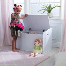 Girl taking out toy from white Toy Box