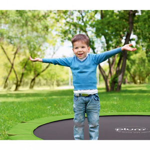 Plum® 12ft Circular In-Ground Trampoline - Boy Jumping - Lifestyle Image