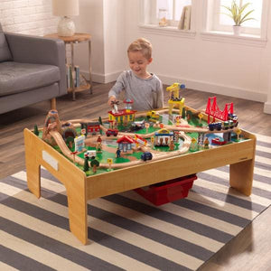 Boy playing with train table