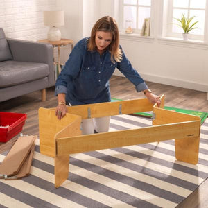 Woman folding Kids Train Table