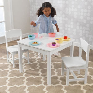 Girl and White Wooden Table with 2 Chairs