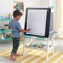 Boy drawing on White Art Easel