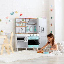 Kids Play Kitchen - Girl playing on the floor