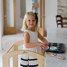 Girl standing on kids kitchen stool - Little Partners - The Original Learning Tower