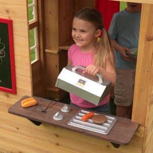 Girl playing cooking in Modern Outdoor Playhouse