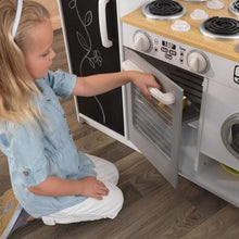 Girl using oven - Kids Play Kitchen - White