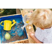 Plum® Surfside Sand And Water Table - Boy pouring water into water table