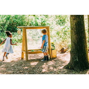Plum® Discovery Create & Paint Easel - Boy and Girl playing outdoors