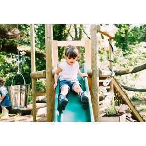 Plum® Discovery Woodland Treehouse - Girl Sliding Down Slide