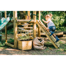 Plum® Discovery Woodland Treehouse - Girl Climbing on Play Set