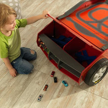 Boy storing car into Kids Car Activity Table