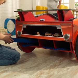 Boy storing race tracks into Kids Car Activity Table