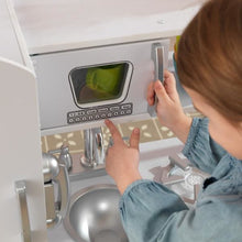 Girl using microwave - Kids Play Kitchen