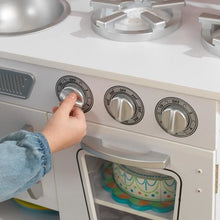 Girl using stove buttons - Kids Play Kitchen