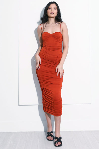 Model wearing our Elisse burnt orange bodycoon midi dress front view.