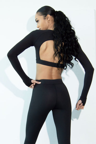 Model wearing our Sia black activewear set back view top close up.