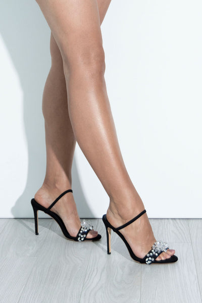Ayra crystal black high heels side views on legs.