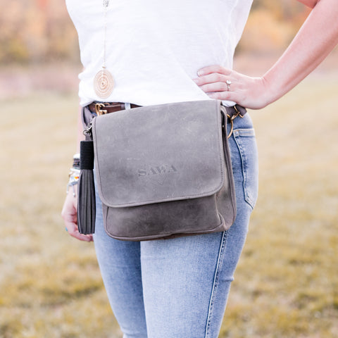 The SAWA Convertible Bag can be worn 4 different ways, making it the perfect travel accessory! Simply adjusting the leather straps will convert this bag from handbag to messenger/crossbody bag, backpack and over-the-shoulder bag in just seconds.