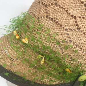 Straw hat with buttons and veiling