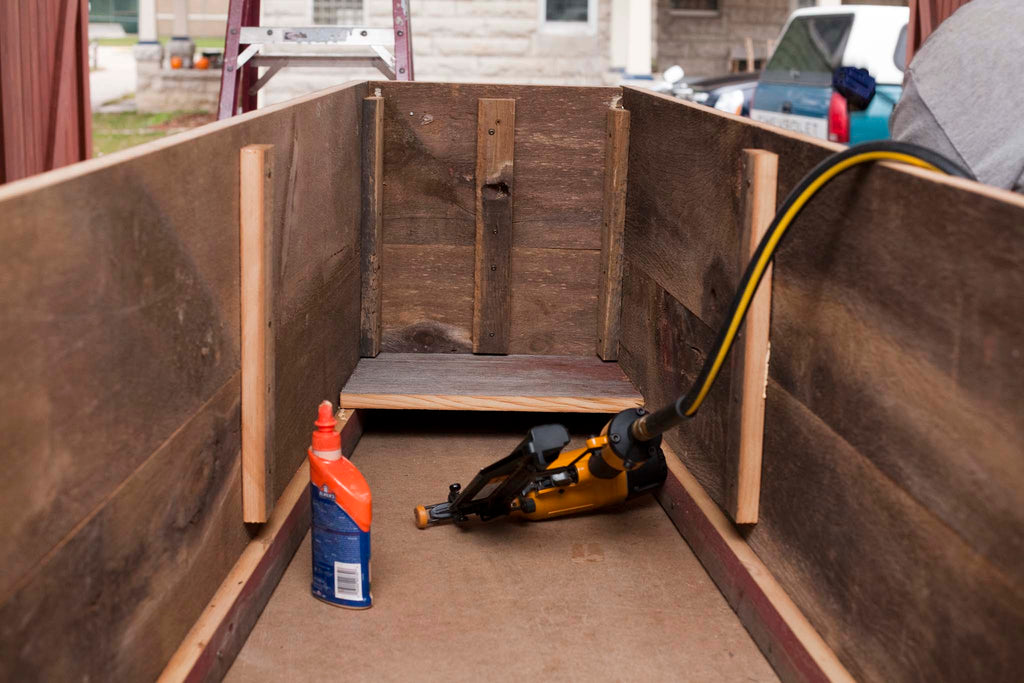 installing floorboard in casket coffin