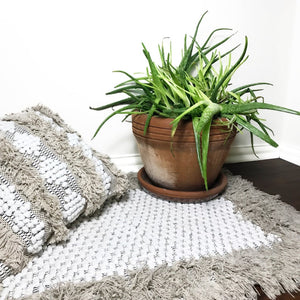 casa boho woven cotton fringe tassel textured bohemian neutral area rug mat home decor idea ideas tan beige taupe ivory cream plant