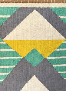 close up woven fringe aqua yellow geometric boho tribal wall hanging