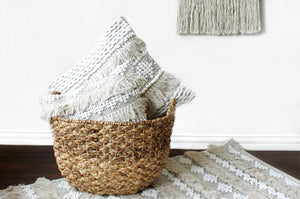 casa boho neutral cotton textured sea pillow cover with fringe beige Boho bohemian neutral decor cotton throw pillow tan beige white cream taupe pictured in basket in room with neutral decor