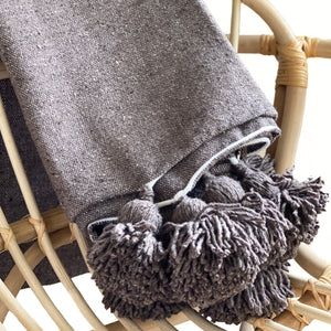 Brown bohemian moroccan pom pom throw blanket, warm, soft, cozy, fall decor, decorative, baby room, nursery, bedroom, sofa, couch, casa boho, textiles online boutique, shop, eclectic