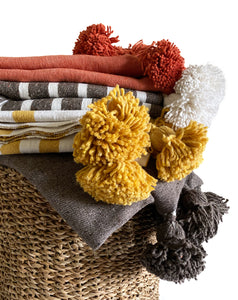 casa boho moroccan pom pom throw blankets burnt orange yellow gold mustard rust brown ivory cream white stirped oversized tassels toss