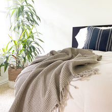 Coastal boho bedroom, waffle weave turkish throw blanket with tassels, neutral bohemian home decor, white walls, light and bright, breezy