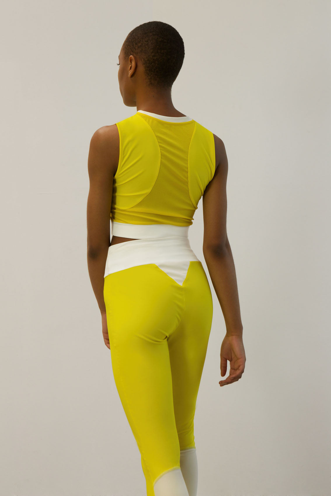 high-waist tights made from recovered sea fishing nets | energetic yellow - ivory