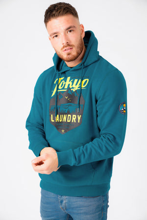Calegreen Outdoor Motif Brush Back Fleece Pullover Hoodie In Moroccan Blue – Tokyo Laundry