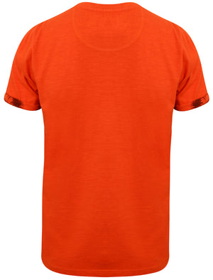 Akamu Printed Roll Sleeve T-Shirt with Pocket in Paprika - Tokyo Laundry
