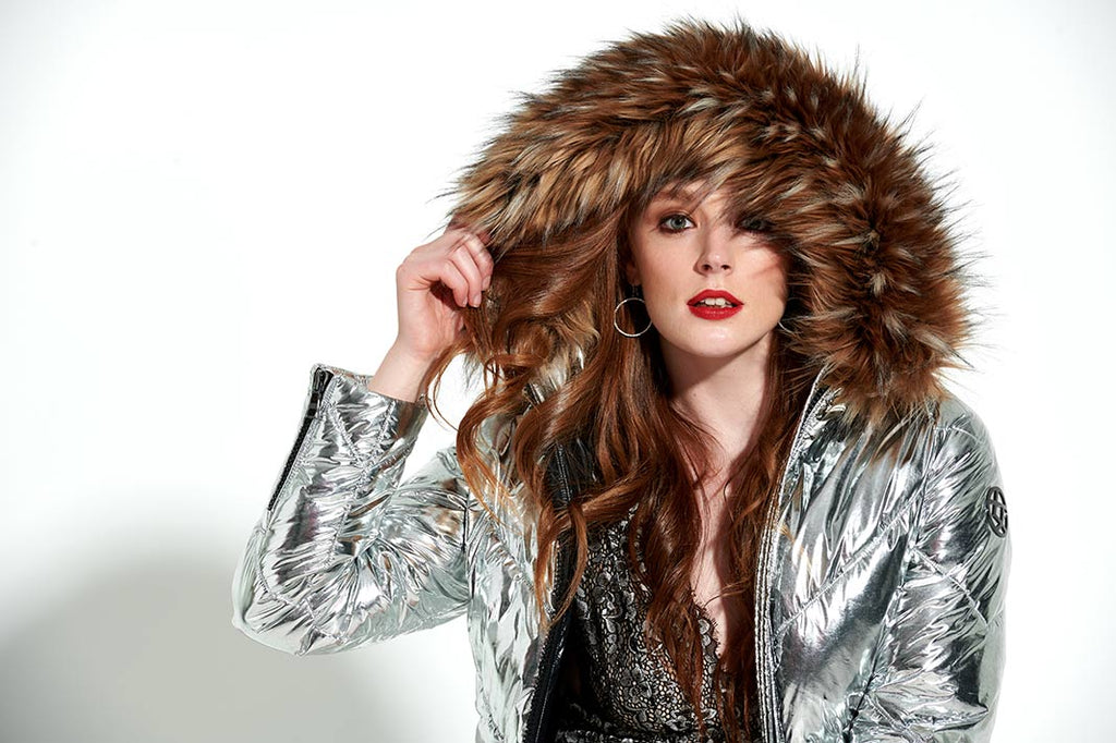 silver puffer with luxurious interchangeable faux fur collars. 100% recycled fabric and insulation and 100% vegan
