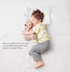 Kid on bed with comfydown pillow