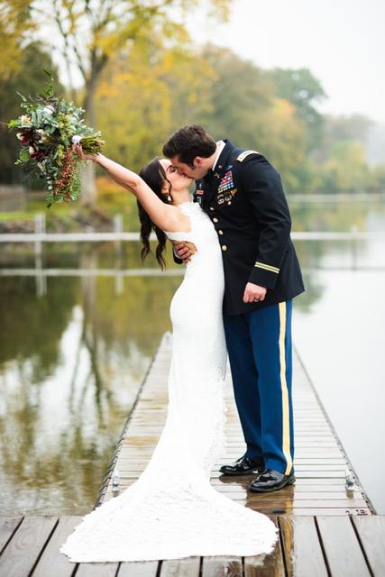 A lovely couple kissing each other on thier engagement day