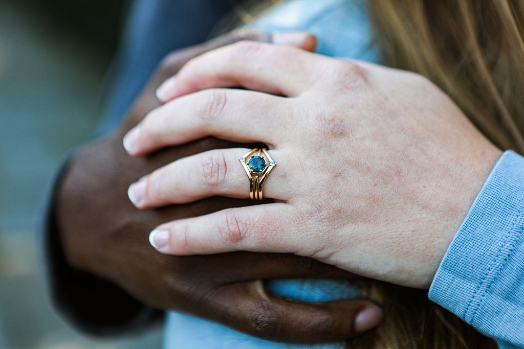 A girl wearing round sapphire ring on her index finger