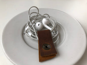 Cord holder in brown leather