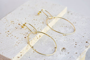 Linked hoop drop earring in gold